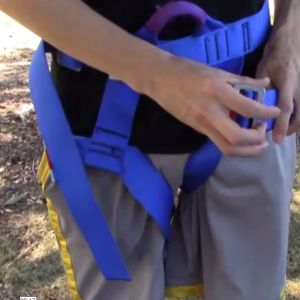Learn about using a harness safely when belaying.