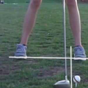 Learn how to hit a golf ball.