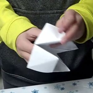 Learn how to make an origami fortune teller.