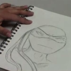 Learn how to sketch a ninja turtle.
