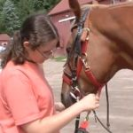 Learn how this young woman takes care of animals and helps children at the same time.
